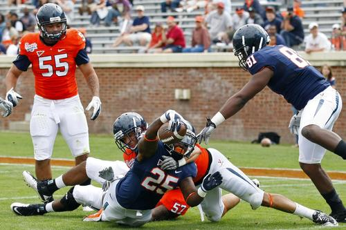 Virginia Cavaliers running back Kevin Parks (25) runs with the ball for a touchdown as Cavaliers safety Mason Thomas (46) defends during the Virginia spring game at Scott Stadium.