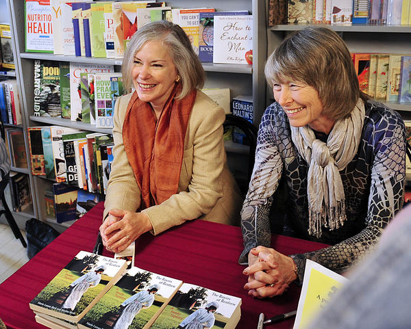 """Local authors Marie Lanser Beck, left, and Maxine Sheeley Beck attend a book signing with their book titled """"The Royers of Renfrew,"""" Saturday at Turn the Page Bookstore in Boonsboro."""