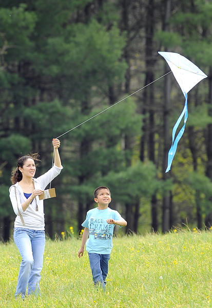 Farianna Bermejo, left, and her 7-year-old son Roberto Orihuela of Chambersburg fly their kite Saturday afternoon at Renfrew Park in Waynesboro during the 18th Annual Spring Fun Fly.