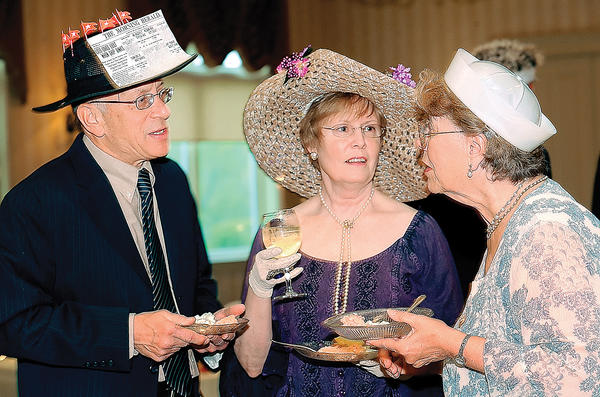 Bob and Babs Savitt, left, of Myersville, enjoy drinks and conversation with Linda Irvin-Craig Saturday night at Foutain Head C.C. during the 2nd Annual Mad Hatter's Ball to benefit the Washington County Historical Society. Bob is the society's Vice President and Linda is the Executive Director.