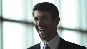 Phelps takes a break from training to participate in fundraiser
