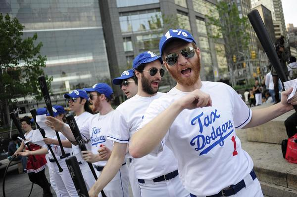 "Members of the Occupy Wall Street dressed as a baseball team named ""The Tax Dodgers"" participate in a rally near Central Park in New York."