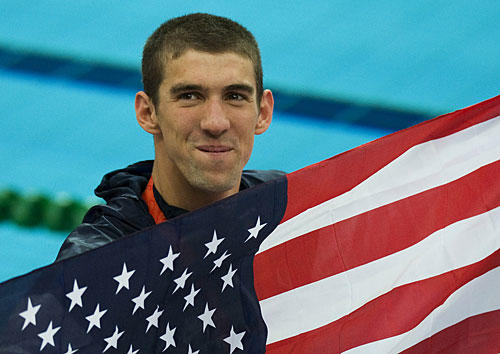 Michael Phelps holds a U.S. flag after winning his eighth gold medal of the Beijing Games, breaking Mark Spitz's 36-year-old record for golds in a single Olympics. The Rodgers Forge native capped his historic run by helping the U.S. 4 x 100 medley relay team win the gold medal in a world-record time of 3 minutes, 29.34 seconds.