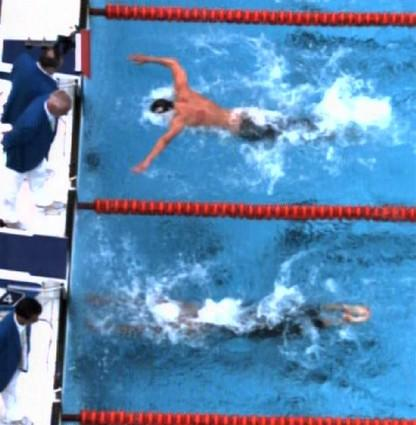 This image taken from International Olympic Committee Beijing Olympic Broadcasting pool video shows Michael Phelps, above, as he swims toward the finish of the 100-meter butterfly, along side Serbia's Milorad Cavic in the adjacent lane. Phelps beat Cavic by one-hundreth of a second, earning his seventh gold medal and matching Mark Spitz's record from the 1972 Munich Games.