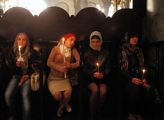 A bench of worshipers from Russia listen to the candlelight resurrection service being give at the Church of St. George at the Ecumenical Patriarchate, center of the Orthodox Christian Church.