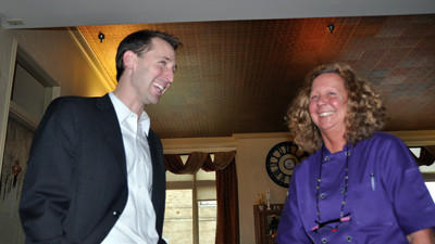 U.S. Senate candidate Steve Welch speaks with Alice Ireland, owner of Crazy Alice's Cafe, Saturday in uptown Somerset.