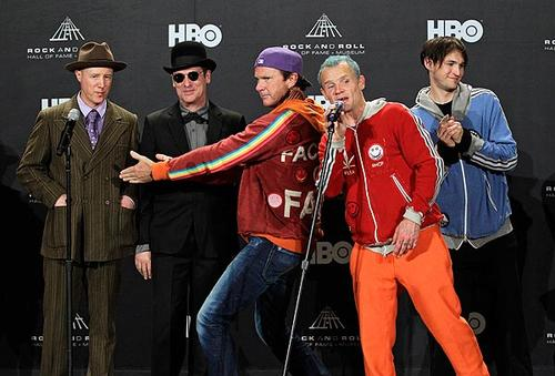 """Red Hot Chili Peppers drummer Chad Smith, center, introduces former members Jack Irons, left, and Cliff Martinez with Mike """"Flea"""" Balazary, second from right, and Josh Klinghoffer before the group was inducted into the  Rock and Roll Hall of Fame on Friday, April 13, 2012, in Cleveland."""