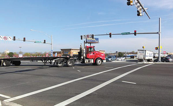 Washington County's recent project at the intersection of Halfway and Massey boulevards created two left-turn lanes in each direction. Problems have been experienced when a tractor-trailer is in the rightmost left-turn lane at the same time that a vehicle makes a left from the rightmost left-turn lane from the opposite direction.