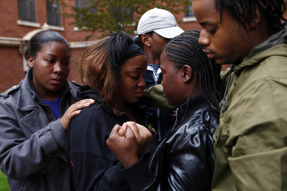 Brittany Cotton, center, is surrounded by her family Sunday after her 2-year-old daughter Armaney died from a beating while in the care of  a man Saturday night. (Michael Tercha/Chicago Tribune)