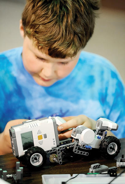 Armand Martenot, 12, of Hagerstown used a LEGO Mindstorms kit to build his robot Sunday afternoon at the Washington County Agricultural Education Center in Sharpsburg.