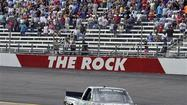 Kasey Kahne celebrated NASCAR's return to Rockingham Speedway with a win Sunday in the Truck Series race.