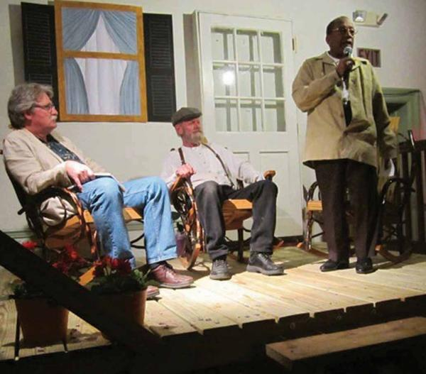 "Randy Tremba, left, and Jay Hurley listen as Clifford Branson tells his story during ""Left of the Bank: Shepherdstown Stories"" Friday night in Shepherdstown, W.Va."