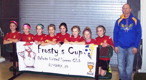 Hub City Soccer U12 club Heat won first place in their division at the Frosty Cup in Bismarck, N.D. From left are Jadyn Brandon, Eden Schanzenbach, Hillary Mantone, Brittney Senger, Nico Jung, Sophie Schriver, Jada Hirsch, Abby Brennan and coach John Zueger.