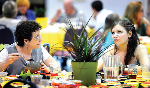 Julie Raulli, left, of Chambersburg, Pa., shares a bowl of soup and conversation with Shauna Pieruccini, right, of Shippensburg, Pa., Sunday afternoon during the Soup for Soul event held at Central Presbyterian Church in Chambersburg.