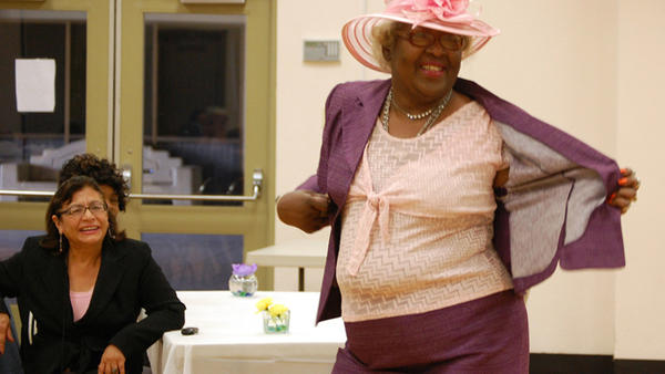 Mary Hunter entertains the crowd at a fashion show held Saturday at the El Centro Community Center for the senior citizen club.