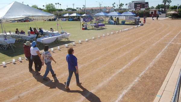 Groups walk around the Calexico High School track for the Relay of Life event held from Saturday to Sunday.