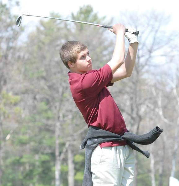 Michael Muller of Harbor Light Christian follows his tee shot during the Inland Lakes Chuck Palmer Memorial Invitational Saturday at Indian River Golf Club.