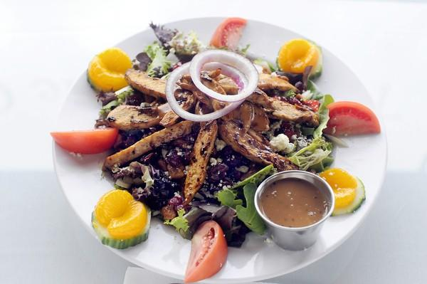 The signature salad at the Parkside Cafe is Emma's Balsamic Chicken Salad, consisting of fresh field greens, assorted seasonal veggies, mandarin orange slices, bleu cheese crumbles, honey walnuts and craisins.