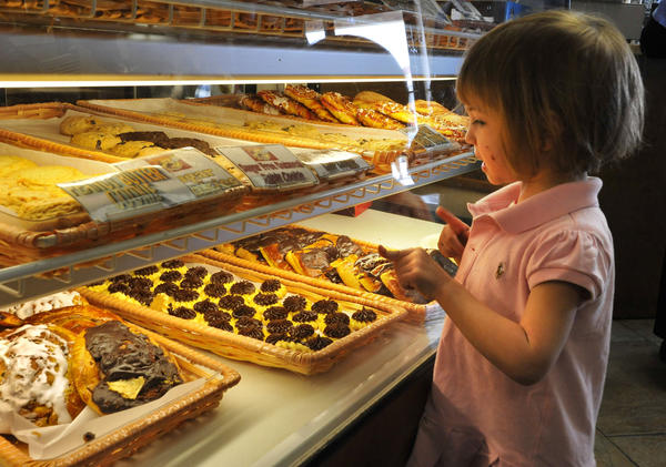 Caroline Hirsch, 3, of Baltimore, examines the pastries at Goldberg's New York Bagels, which are not eaten during Passover by observant Jews. The bakery had an extra busy Sunday as Jewish customers stocked up on leavened bread products after Passover.