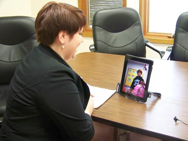 Erica Dwyer, a speech and language specialist for the Charlevoix-Emmet Intermediate School District, works with students on Beaver Island via iPad technology.