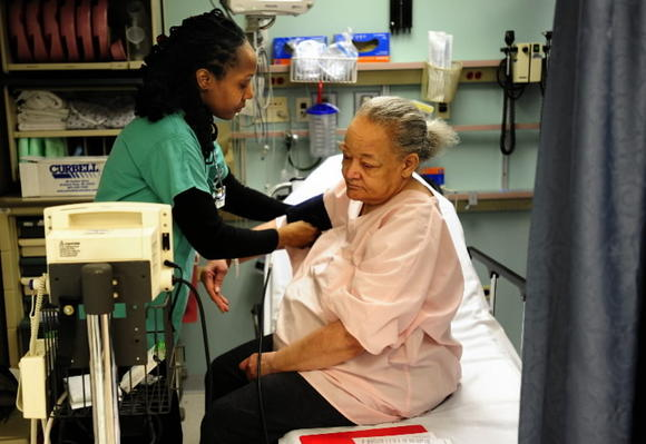 A patient gets her blood pressure taken at Bon Secours Hospital in West Baltimore