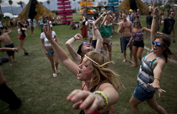 Bailey Olstrom, center, joins dancers on the opening day of the Coachella Valley Music and Arts Festival, April 13, 2012 in Indio, California.