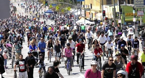 Cyclists make their way east down 7th Street near MacArthur Park during CicLAvia on Sunday.