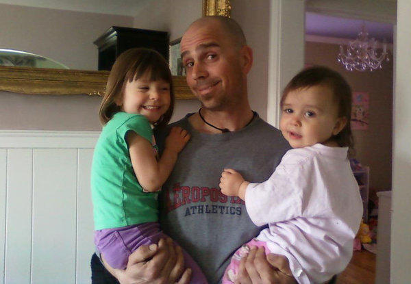 Anthony Hensley, 37, holds his daughters Hayden Rose, 3, left, and Gabriella, 1, right. Hensley was killed when his kayak tipped over while tending to the swans at Bay Colony Drive apartments in unincorporated Cook County near Des Plaines.