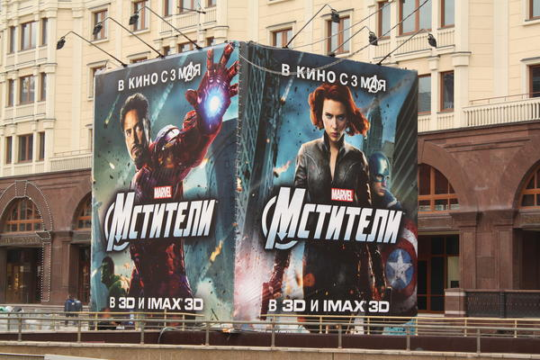 "Street ads promote the upcoming Russian release of ""The Avengers,"" starring Robert Downey Jr. and Scarlett Johansson."