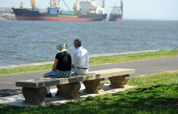 Ann and Bernie Weiss watch ships from Fort McHenry on a 90-degree day April 16.