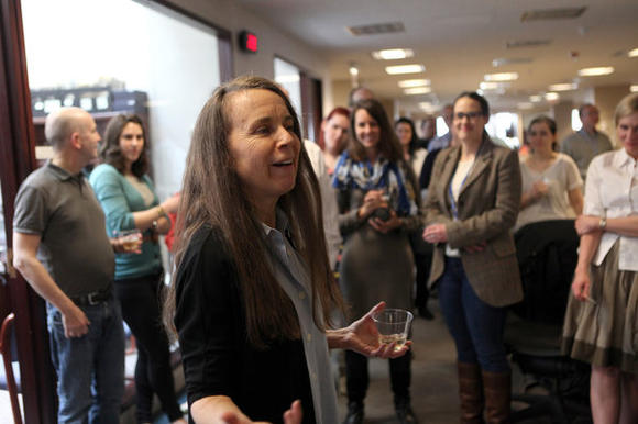 Chicago Tribune columnist Mary Schmich speaks to the newsroom after winning the Pulitzer Prize in commentary writing. ( Nancy Stone, Chicago Tribune / April 16, 2012 )