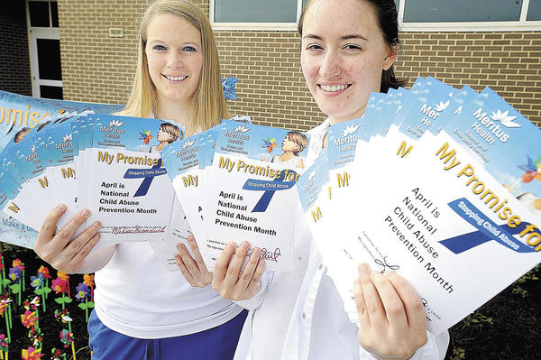 Towson University at USMH nursing students Kayla Willis, left, of Boonsboro, and Melissa Schroyer, of Smithsburg, hold pledge cards signed by the public.