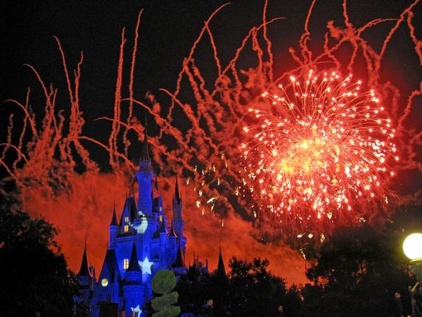 A four-night vacation package for a family of four to Disney World, including airfare, hotel and park passes (priced through Expedia), with $500 left to cover food costs.