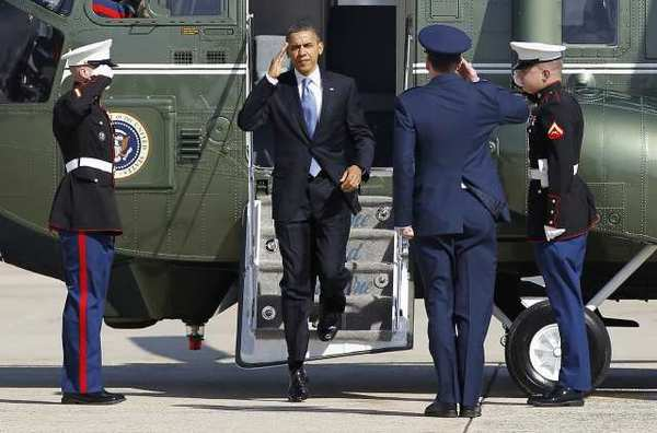 """President Obama is seen stepping off the Marine One helicopter in March. Even before he got the nomination in 2008, Obama said he wanted to be a """"transformative"""" president like Ronald Reagan had been."""