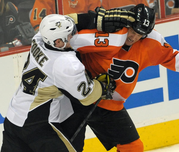 The Penguins' Matt Cooke (24) and the Flyers' Pavel Kubina mix it up during a contentious Game 3 Sunday.