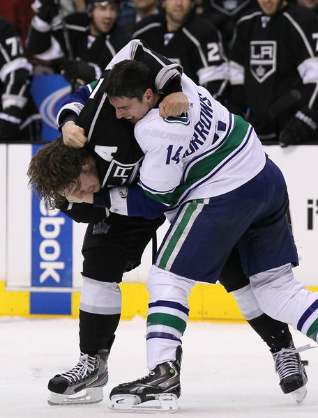 Alexandre Burrows of the Canucks takes on the Kings' Anze Kopitar.