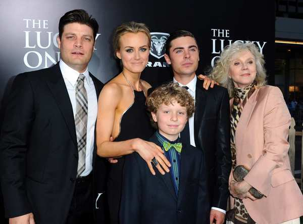 "The cast of ""The Lucky One"" — Jay R. Ferguson, left, Taylor Schilling, Riley Thomas Stewart, Zac Efron and Blythe Danner — arrives at Grauman's Chinese Theatre on April 16 to debut the romantic drama based on Nicholas Sparks' novel. The film opens in theaters April 20."