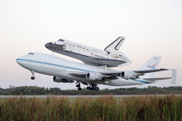 Space shuttle Discovery atop a 747 carrier jet departs the Kennedy Space Center in Cape Canaveral, Fla., Tuesday. Discovery is being transported to the Smithsonian National Air and Space Museum in Washington.