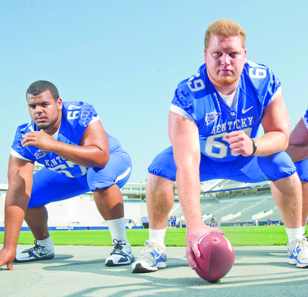 Kentucky lineman Larry Warford, left, said filling in for center Matt Smith, right, during spring practice was not as easy as Smith made it out to be.