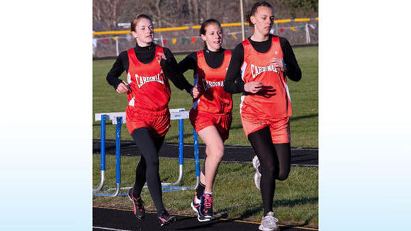 J-L earned a clean sweep in the 800-meter run Thursday with Hailey Weaver (right) placing first, Julia Nieman (left) second and Chloe Johnston (middle) third