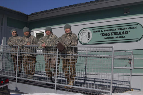 Maj. Naranzul Tumurbaatar, Lt. Col. Elbegjargal Buyantogtokh, Lt. Col. Delgersaikhan Tudev and Lt. Ichinkhorloo Erdene Ochir, all of the Mongolian Armed Forces, stand in front of the health clinic in Golovin, Alaska, April 15.