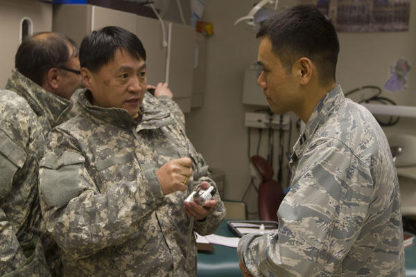 Lt. Col. Elbegjargal Buyantogtokh (left) speaks to Air Force Capt. Alex Kwon, an optometrist from Joint Base Elmendorf-Richardson. Buyantogtokh is an optometrist with the Mongolian Armed Forces who travelled to Alaska to see operations during Arctic Care 2012.