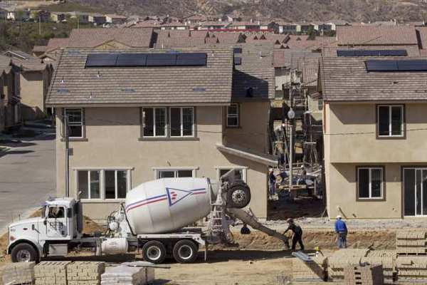 New homes under construction in Santa Clarita last month. U.S. builders started work on fewer homes in March while requesting the most permits for future projects in 3½ years.