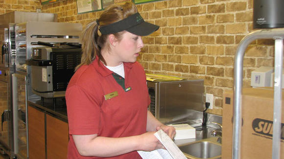 Manager Trish Newhouse oversees a delivery at the recently opened Subway, located in Gaylord's Meijer.