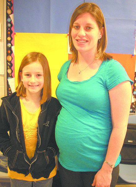 Sarah DeMuth is shown with her teacher, Aylson Carver.