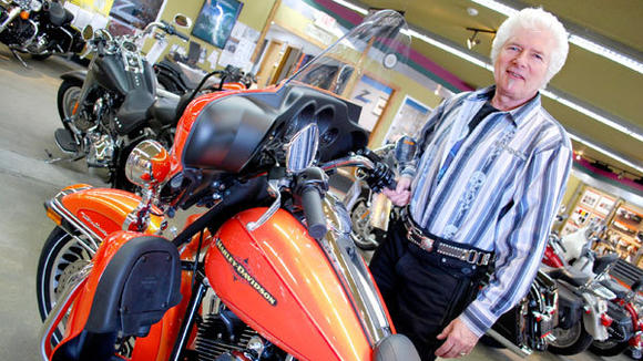Elvis shows off one of his favorite motorcycles in the showroom at Zips 45th Parallel Harley-Davidson in Gaylord. He said he¿s waited years for last week's repeal of Michigan's motorcycle helmet law.