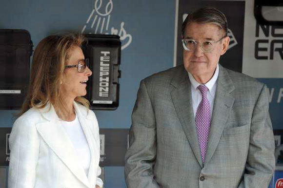 Peter O'Malley and his wife, Annette, stand in the Dodger dugout prior to this season's home opener.
