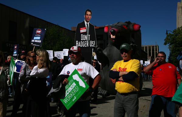 Union members rally along Adams Street in Springfield outside a speech by Wisconsin Gov. Scott Walker before the Illinois Chamber of Commerce and the National Federation of Independent Business.