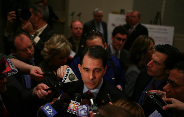 Wisconsin Gov. Scott Walker talks to the media after his speech to the Illinois Chamber of Commerce in Springfield, Ill.