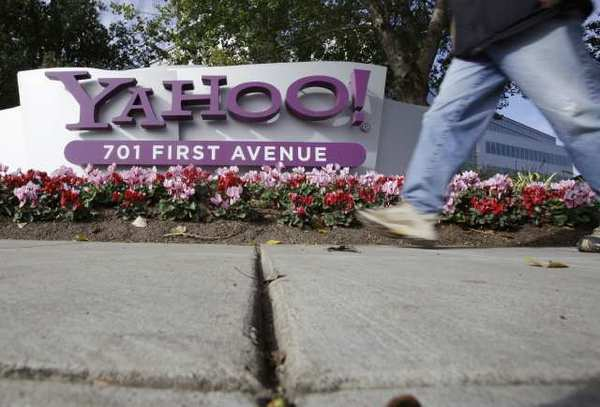 A man walks by Yahoo's headquarters in Sunnyvale, Calif.